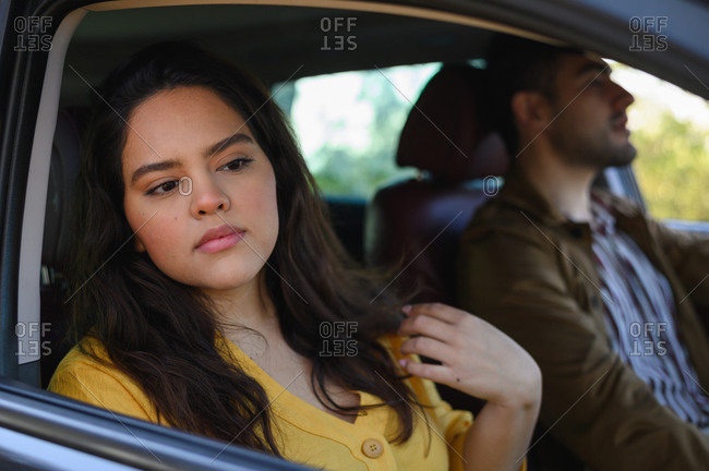Handsome girl and man travelling together on a road trip while driving