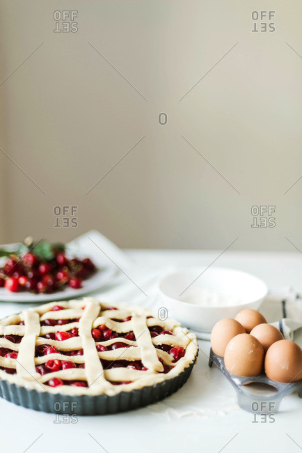 Overhead view of pie served in plate on white table