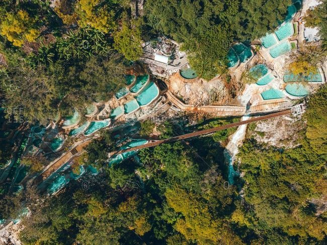 Aerial drone view of bright blue natural hot springs, Tolantongo