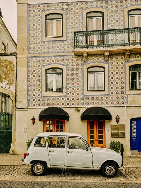 Lisbon, Lisbon, Portugal - October 18, 2019: Cute blue car in front of tiled building
