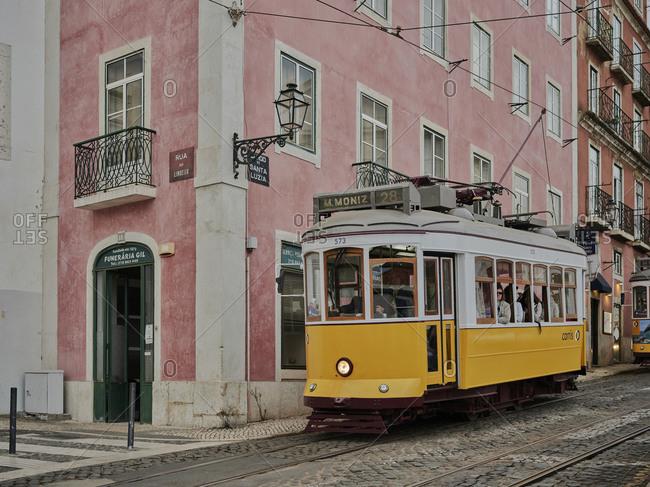 Lisbon, Lisbon, Portugal - October 18, 2019: Lisbon tram going down Alfama street