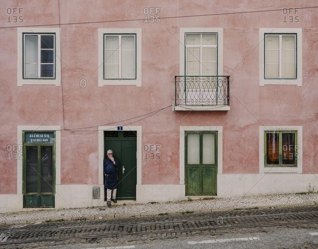 Lisbon, Lisbon, Portugal - October 18, 2019: Male worker taking a smoke break in Alfama
