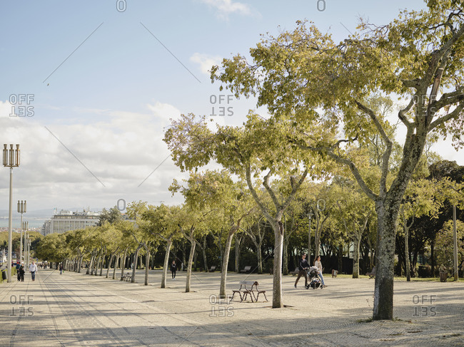 Lisbon, Lisbon, Portugal - October 19, 2019: Family out for a stroll in Parque Eduardo VII