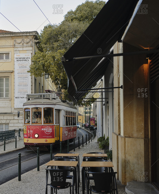 Lisbon, Lisbon, Portugal - October 19, 2019: Lisbon tram going through empty city streets
