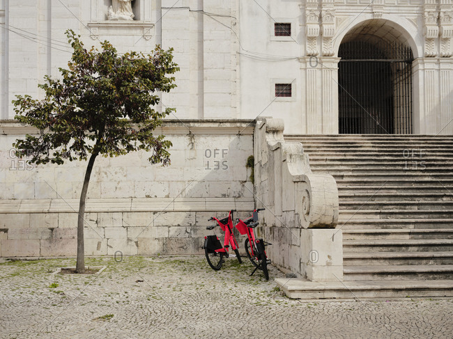 Pair of bikes outside of building in Lisbon