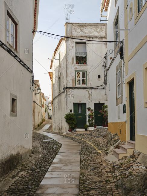 Old cobble stone lined village street in Castelo De Vide