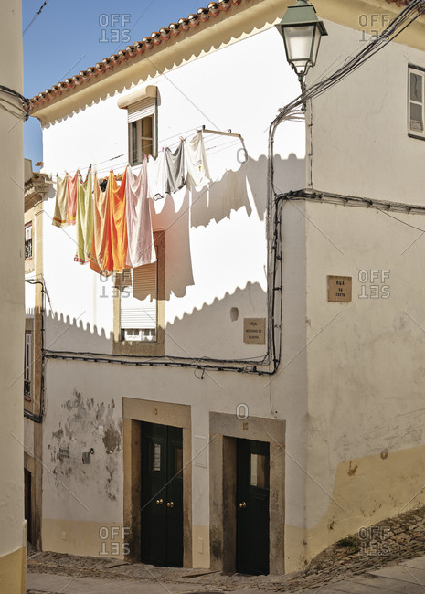 Hanging clothes on cobble stone street in Castelo De Vide