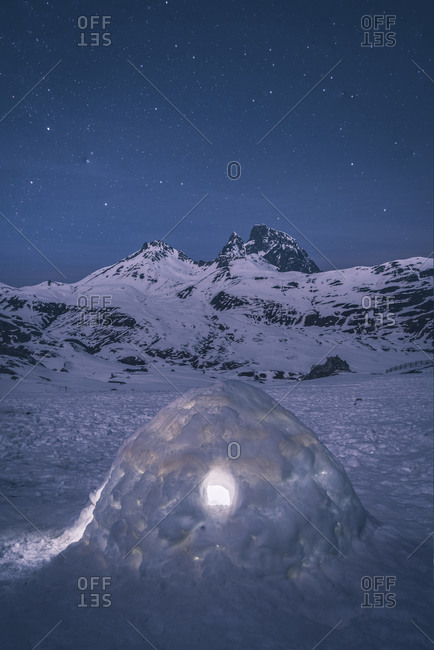 Igloo under starry sky against Midi d'Ossau during winter, Laruns, Fr