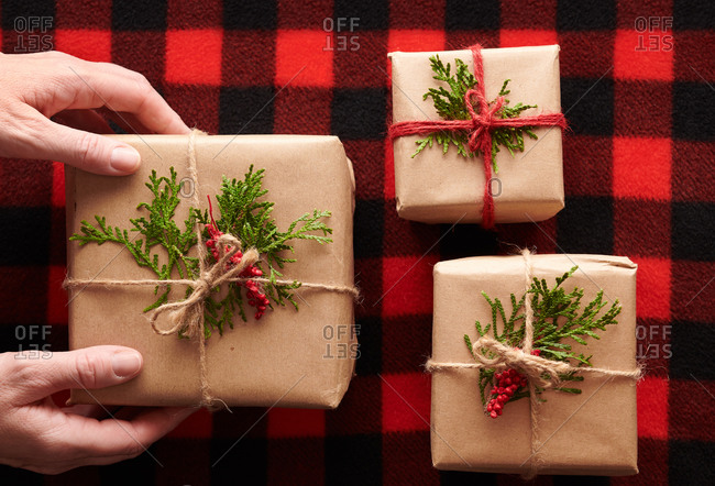 Hands Placing Gift - Rustic Christmas Gifts
