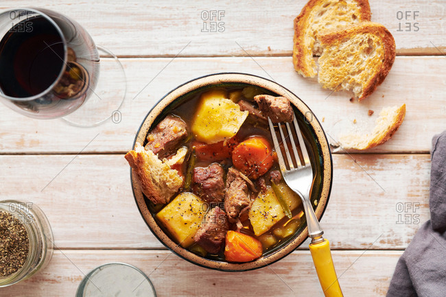 Hearty Veal Stew in Bowl with Wine