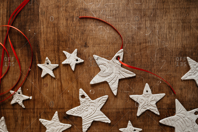 DIY clay star ornaments on rustic table