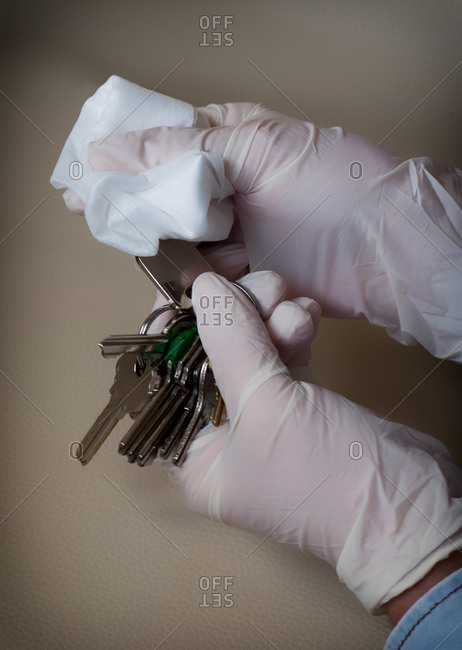 Hands Disinfecting Some Keys. COVID-19