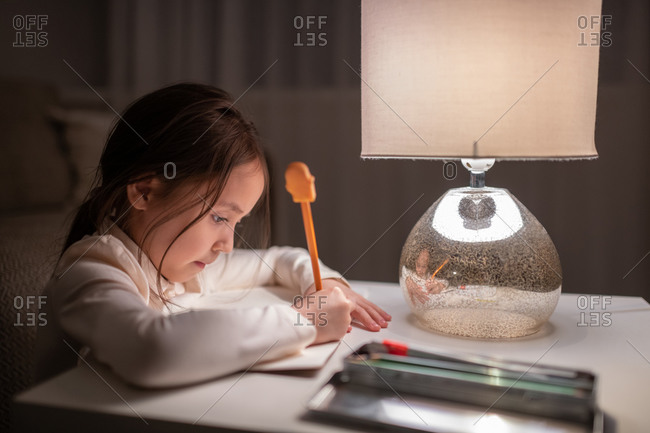 Ethnic girl drawing at home