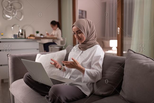 Muslim mother having virtual meeting at home
