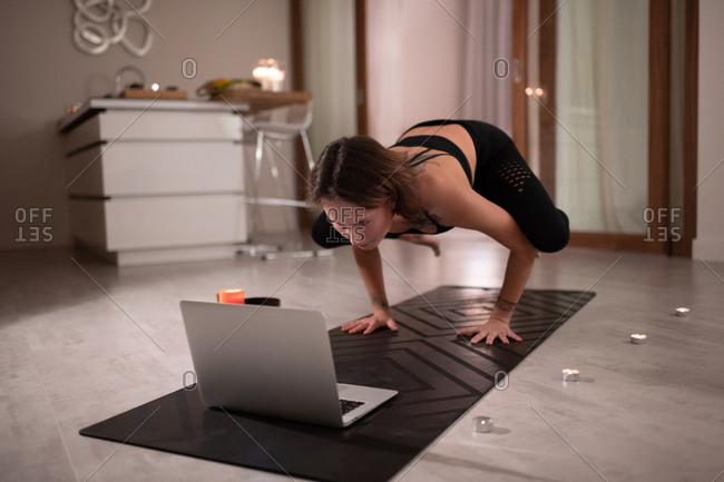 Woman having online yoga lesson