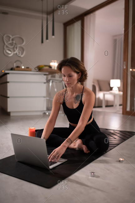 Yoga practitioner using laptop during online lesson