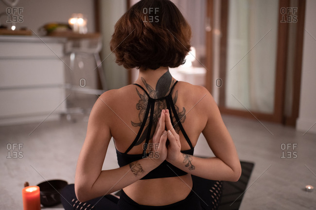 Yoga practitioner clasping hands behind back