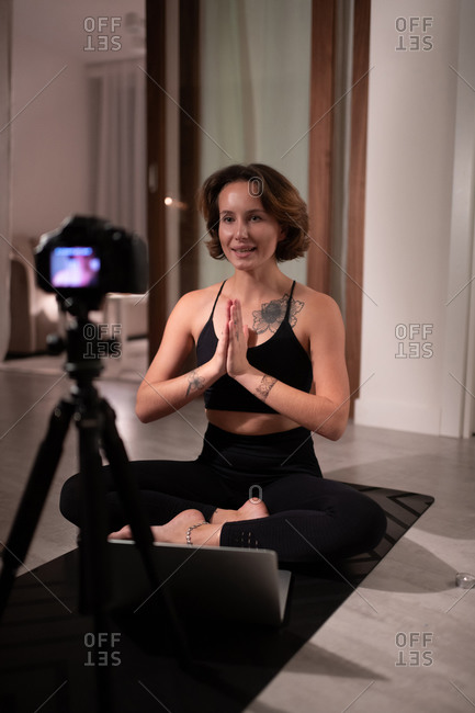 Yoga instructor greeting online students