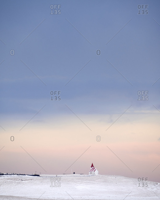Lonely house on snowy hill