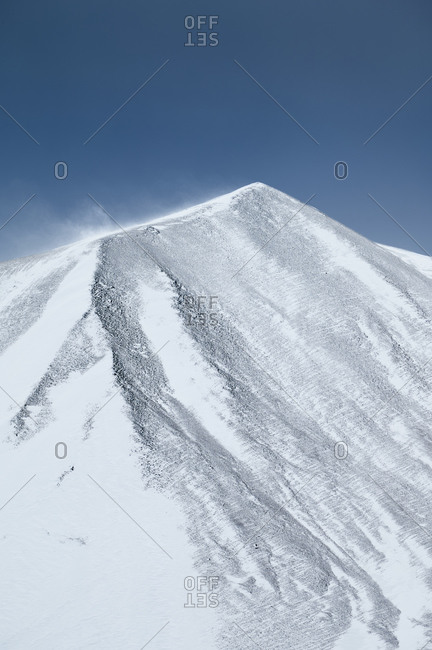 Snowy mountain against cloudless sky