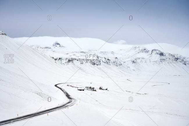 Curvy road through snowy mountainous terrain