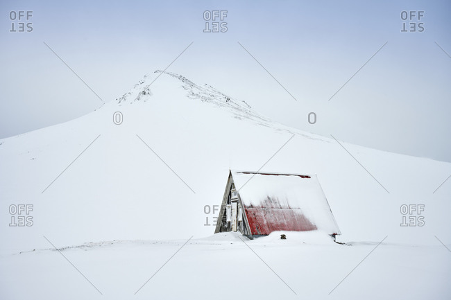 Lonely house in snowy northern terrain