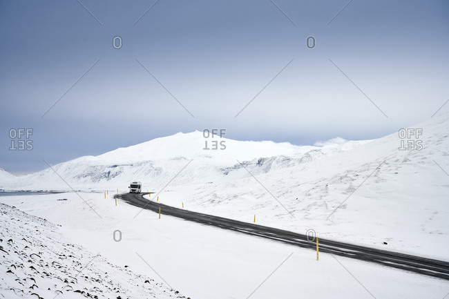 Wild northern winter landscape with car on road