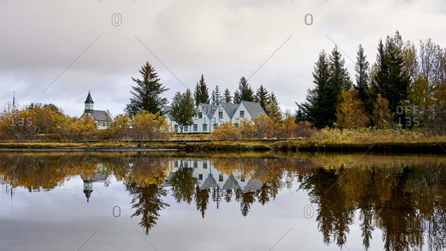 Houses and autumn trees on lake shore