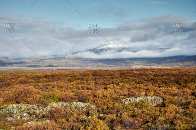 Cloudy sky over autumn countryside