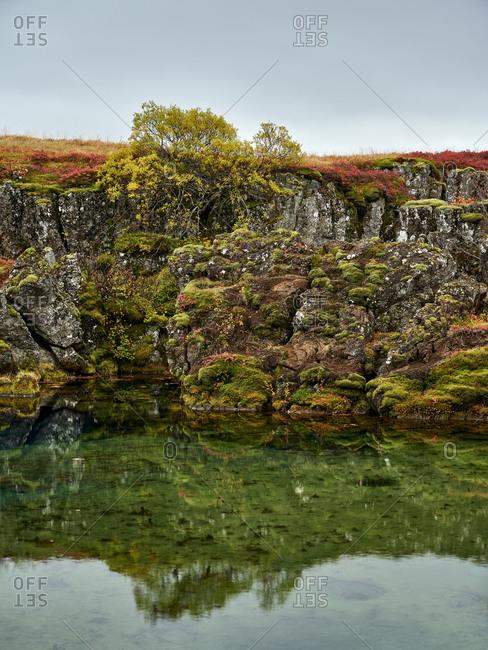 Nordic autumn landscape of lake with rocky coast