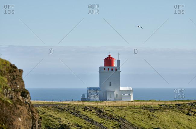 Lighthouse on seashore in morning