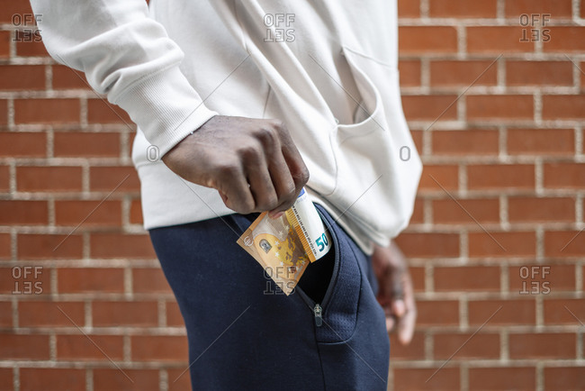 Close-up of African man pulling out a 50 euro bill from a pocket