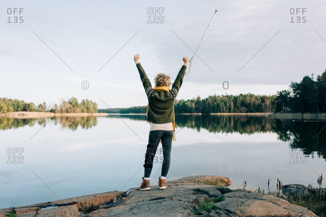 injured woman celebrating walking by the coast in Sweden