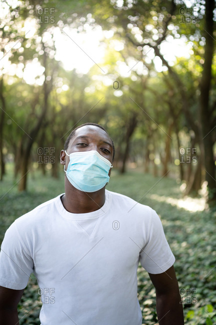 A young black man with a mask in the covid-19 pandemic season.