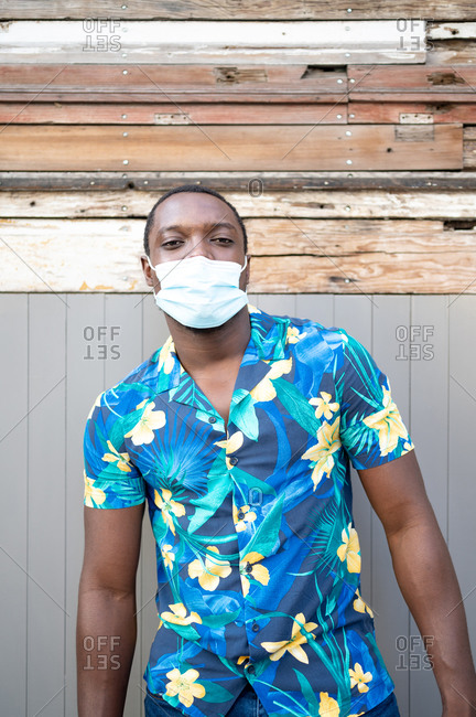 A young black man with a mask in the covid-19 pandemic season