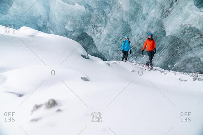 Friends Exploring Frozen Ice Caves In Alberta