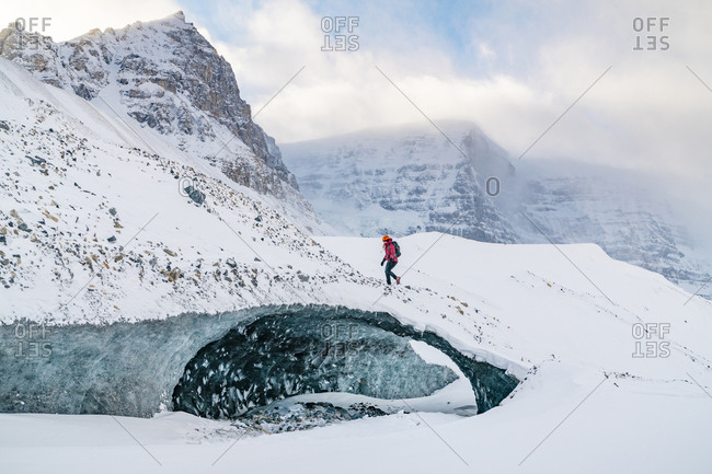 Mountaineer Climbs Ice Cave On Icefields Parkway