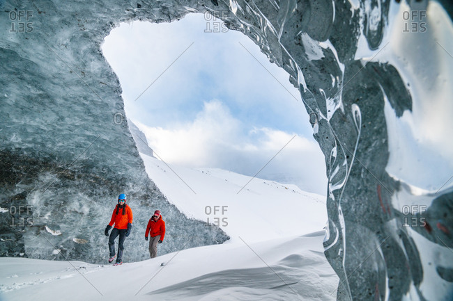 Couple Exploring The Inside Of Glaciers On The Icefields Parkway