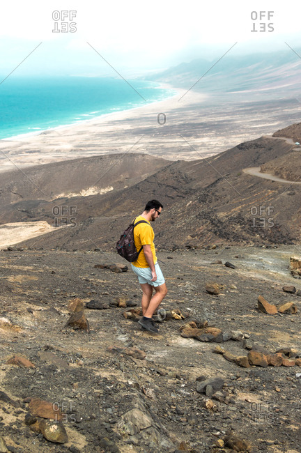 Man traveling between sea and mountains in Jandia Park, Fuerteventura