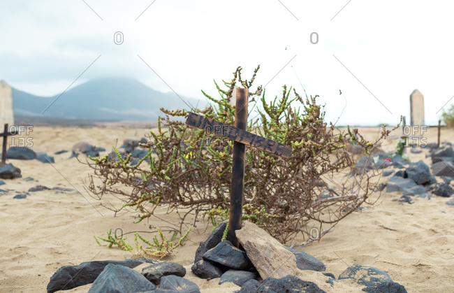 Nameless grave in abandoned cemetery on a beach. Cofete beach in Fuerteventura, Canary Islands.