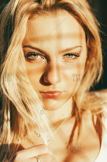 Look Of A Beautiful Blonde Girl In A Plane Of Lights And Shadows