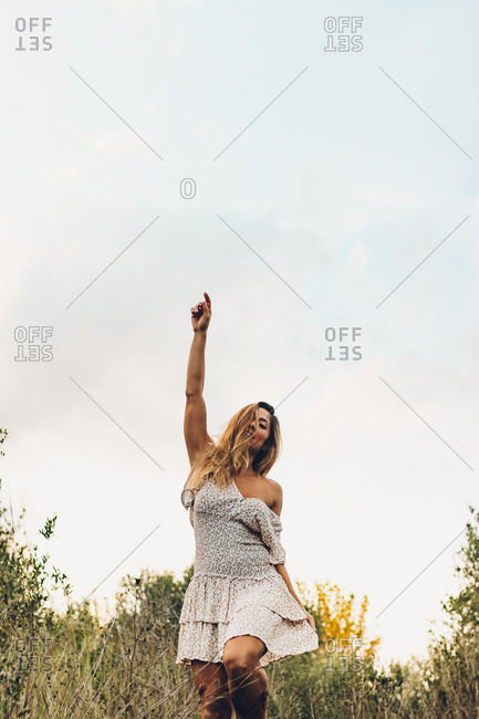 Beautiful Woman Outdoors Raised Arm Smiling