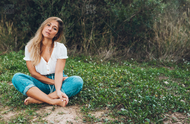 Woman Sitting On The Grass Beside The Picture