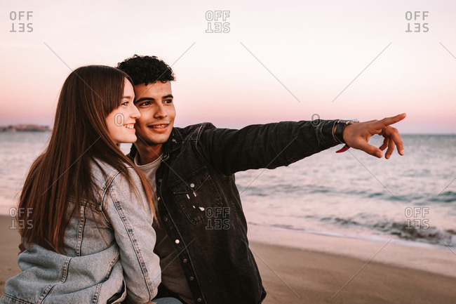 Young Couple On The Beach Having Good Times
