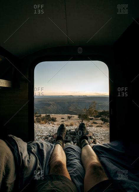 POV view of legs out of camper door looking at desert landscape, Utah