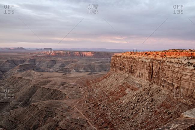Mesa and canyon of the remote desert on Utah Arizona border at sunrise