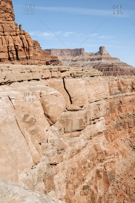 red pick up truck on the edge of a cliff near Moab Utah