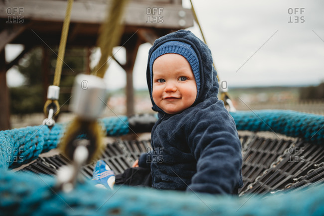 Cute baby boy at a playground during winter