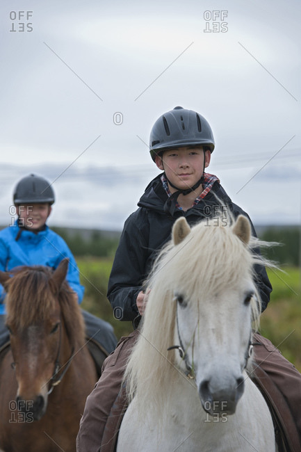 two brothers riding Icelandic horses in remote location