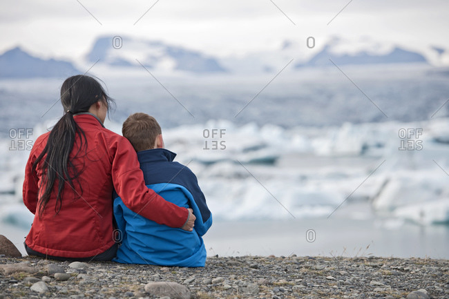 Mother and son looking at glacier lagoon in Iceland